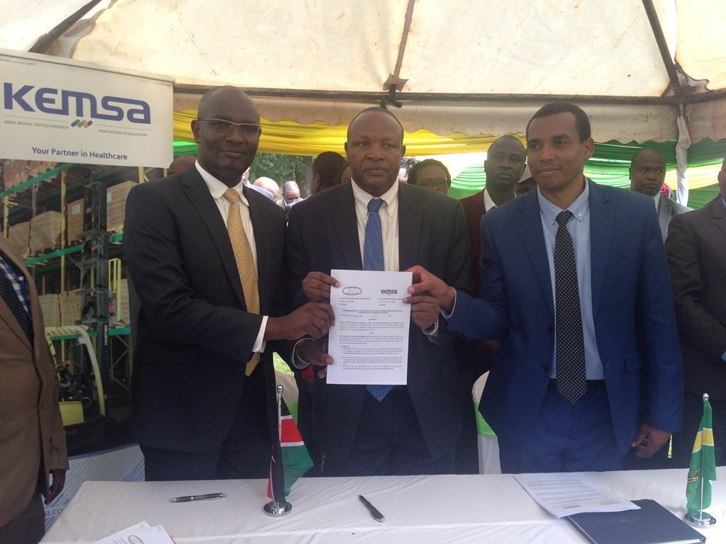 Kericho County Governor H.E Prof. Paul Chepkwony display signed MoU together with KEMSA Director Commercial Services Mr. Eliud Muriithi ( L )and Kericho County CEC Health Dr. Shadrack Mutai at Kericho