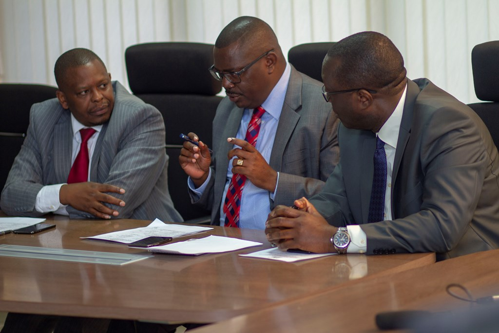 (From L) Dr. Manjari, Mr Wambua and Mr. Onyach making brief discussions during the PC signing ceremony.